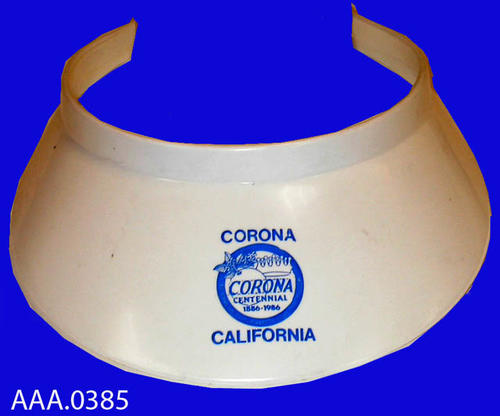 "This artifact is a white visor with the logo of the City of Corona.  This following text is imprinted on the visor:  ""Corona Centennial 1886-1986 - Corona above the logo with California under the logo."