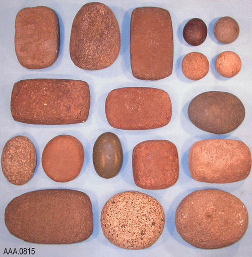 "This artifact collection consists of 18 water worn stones that may have been used as hammer or grinding stones. The small round stones are approximately 2"" in diameter, while the large rectangular stones are approximately 3"" x 6"".  CONDITION:  Moderate wear from use."