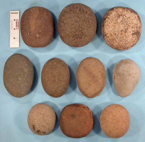 This artifact collection consists of ten, water worn stones that may have been used as hammer or grinding tools.  CONDITION:  Wear due to slight use.