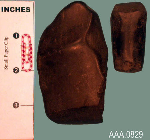 This artifact collection consists of (2) three-quarter grooved axes from the Ohio Valley.  C. 500-1000 A.D.  Their measurement in inches is as follows:  (A) 3 1/2 x 2; (B) 2 x 1 1/4.