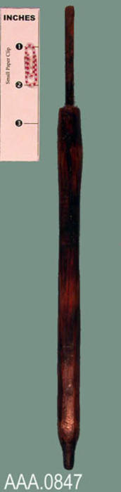 This artifact is a screw driver with a long wooden handle.  The age and source of this artifact is unknown.