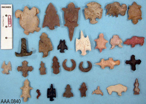 "This artifact collection consists of twenty-nine, chipped flint animal and bird effigies.  These are commonly called ""eccentrics.""  Such items are common on the collector lmarket.  However, there is no documented instance of such from archaeological context.  Most are chipped from broken projectile points."