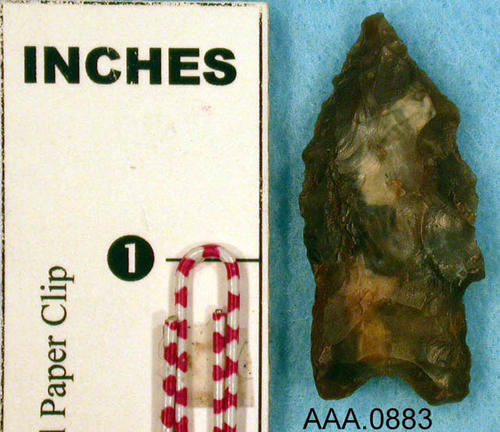 This artifact is a Clovis Man dart point.  Its age is unknown.