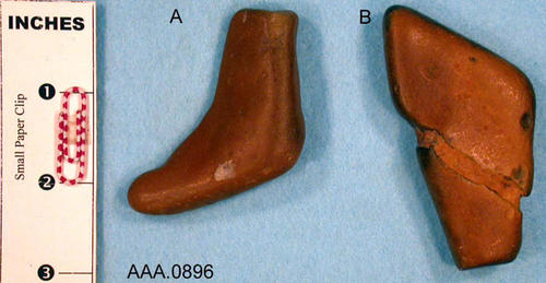 This artifact collection consists of two stones.  (A) is shaped like a mocassin and (B) is shaped like a buffalo hoof.  Their age and source is unknown.