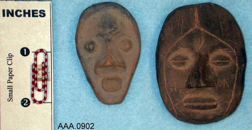 This artifact collection consists of a male and female face molded in clay and fired from spiral mound in Oklahoma, c. 1200 A.D.