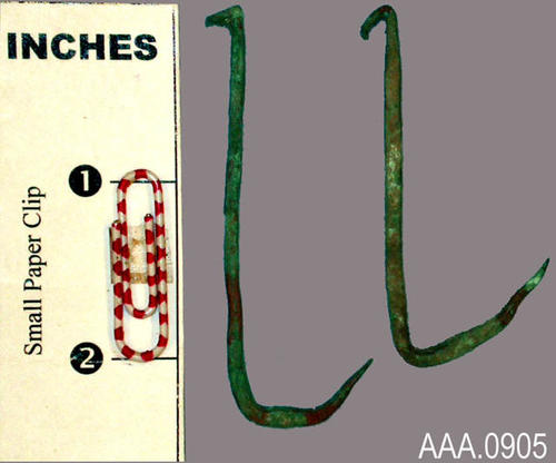 This artifact collection consists of two, copper fish hooks.  Their age and source is unknown.