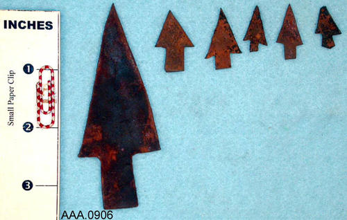 This artifact collection consists of six projectile points made of metal.  One is large and the other five are small.  They were probably cut from metal bands of barrels.  They are believed to be from Texas, c. 1800-1850.