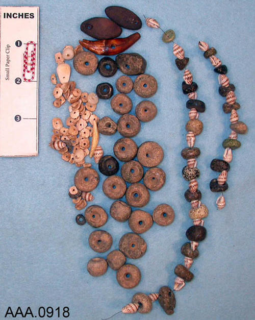 This artifact collection consists of small stones and beads that were once part of a necklace.  The age and source of the beads and stones is unknown.