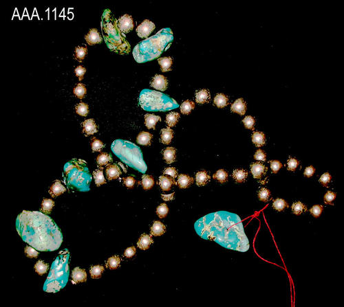 This artifact is a string of silver and turquoise beads.  Their age and source is unknown.