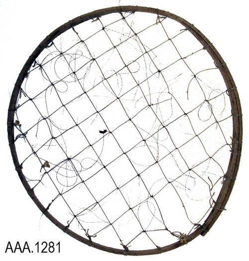This artifact is a Native American artifact.  It is a hand-formed wood hoop with string forming a net.  Where the strings cross, they are tied.