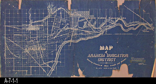 "This map, c. 1880 - 1890, was prepared for the Anaheim Irrigation District and shows the canals and ditches. The map covers a territory showing the cities of Anaheim and Fullerton and extends into the Santa Ana Canyon. - MEASUREMENTS:  18 1/2"" x 37"" - CONDITION:  This map is very deteriorated.  The paper is brittle and many tears.  However, the map color and readability is very good.  -  COPIES:  1 - MAP ORIENTATION:  TOP is NORTH."
