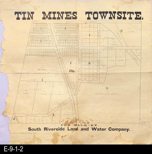 "This map show the layout for the Tin Mine Townsite. Streets and parcel numbers are shown as well as the names of owners for some of the larger land parcels.  MEASUREMENTS: 18 1/2"" X 19"", CONDITION:  The map legibility is excellent; however, the paper has deteriorated. This map will tear very easily.  The upper left section of the map has separated on the horizontal and vertical fold lines. The left edge of the map is ragged. This map is kept in a Mylar sleeve.  COPIES:  1."
