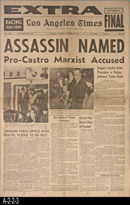 "Los Angeles Times - Vol. LXXXII - Part I, Pages: 24  -  Headline:  Assassin Named, Pro-Castro Marxixt Accused. - MEASUREMENTS:  23"" X 15"" - CONDITION:  There is damage and browing on the horizontal fold line.  A small, 3/4"" square piece is missing from the fold line near the right hand margin.   The newsprint is turning brown.  COPIES:  1."