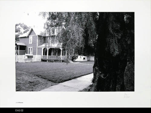 "This BW picture is part of a series of unbound 38 BW photographs taken by Corona photographer Fritz Nicoll.  Most of the photographs feature residences in Corona.  Four in the series are of the Corona Civic Center, and five are untitled photographs. This photograph is a picture of the residence at 1116 Ramona. - MEASUREMENTS:  11 5/8"" x 16 1/2"" - CONDITION:  Excellent -COPIES 1 SET."