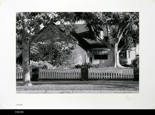 "This BW picture is part of a series of unbound 38 BW photographs taken by Corona photographer Fritz Nicoll.  Most of the photographs feature residences in Corona.  Four in the series are of the Corona Civic Center, and five are untitled photographs. This photograph is a picture of the residence at 224 Kendall. - MEASUREMENTS:  11 5/8"" x 16 1/2"" - CONDITION:  Excellent -COPIES 1 SET."