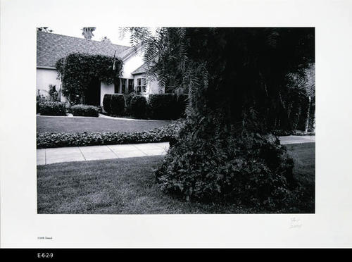 "This BW picture is part of a series of unbound 38 BW photographs taken by Corona photographer Fritz Nicoll.  Most of the photographs feature residences in Corona.  Four in the series are of the Corona Civic Center, and five are untitled photographs. This photograph is a picture of the residence at 1048 Grand. - MEASUREMENTS:  11 5/8"" x 16 1/2"" - CONDITION:  Excellent -COPIES 1 SET."