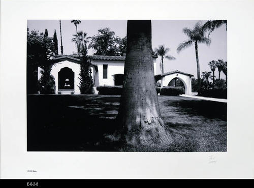 "This BW picture is part of a series of unbound 38 BW photographs taken by Corona photographer Fritz Nicoll.  Most of the photographs feature residences in Corona.  Four in the series are of the Corona Civic Center, and five are untitled photographs. This photograph is a picture of the residence at 1926 Main. - MEASUREMENTS:  11 5/8"" x 16 1/2"" - CONDITION:  Excellent -COPIES 1 SET."