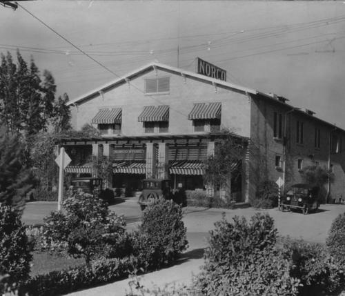 Photo of the Norco Department Store. The store was the hub of community                 activities, and served as the company headquarters. It was a supply center for                 hardware, dry goods, and groceries. The upper floor was used as living quarters for                 some of the Rex Clark employees, and also as a hotel. It was located on old Hamner                 Ave.