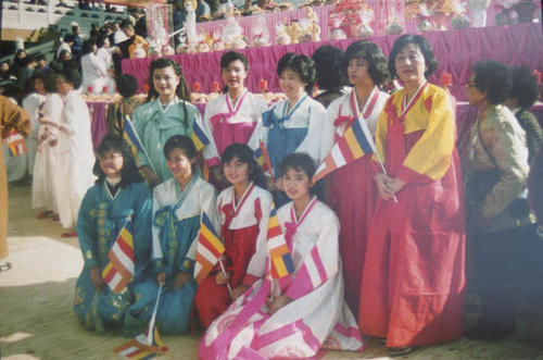 Korean ceremony with the participants in front of a temple.