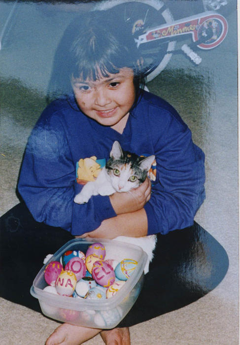 Elora Lyda and her cat and Easter eggs.  Photo taken at 4197 Falmouth Place.