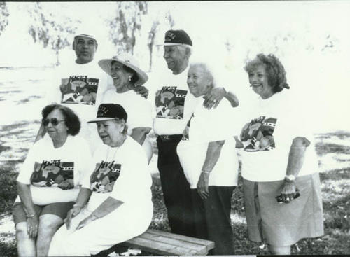 The Maciel family reunion.  Pictured are two older men and five older women.