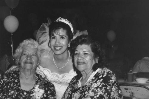 The wedding of Vangie Varela.  Grandmother Vicentia Varela is on the left and Aunt Carmen Mendoza is on the right.  Bride, Vangie Varela, is in the center.