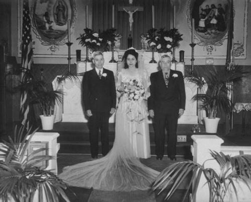 Left to right: Cruz Hernandez (bride's father), Doris Hernandez (bride), Epigmenio Ramos (Rudy Ramos' father).  Photo taken at Our Lady of Guadalupe Church on Park Street in Riverside.