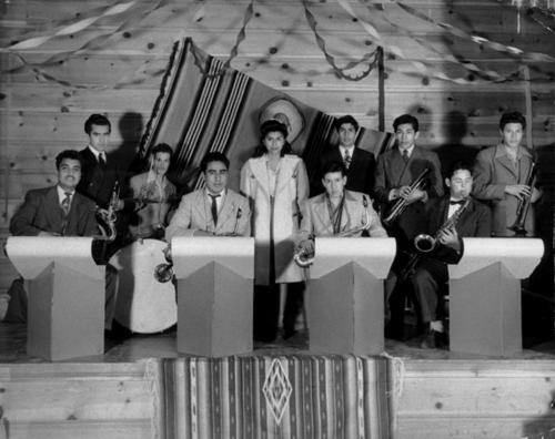 "St. Edwards Hall. ""The Highlights"" Al Lopez, Frank Lopez, William Gonzales Jr, Robert Macias, Daniel Sandoval (drummer). Standing: Frank Torres, Girl Elsie Corral, Robert Cervantes, Joaquin Flores Jr., Larry Mejia."