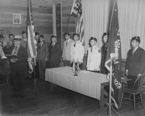 Joe Dominguez. Swearing-in ceremony at the 742 post of the American Legion.  This American Legion post was named after Joe Dominguez , who died on December 27, 1943 in the battle of Arawe in New Britain in World War II.