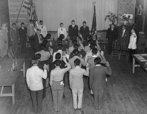 Group of people at Post 742 American Legion ceremony. Joe Dominguez Post 742 of the American Legion, ceremony. This American Legion post was named after Joe Dominguez , who died on December 27, 1943 in the battle of Arawe in New Britain in World War II.