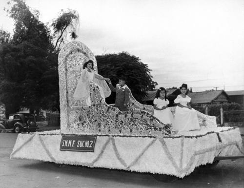 Queen on float at the Lemon Festival. Was to raise funds for Recreation Center. On 3rd and Merrill Street.