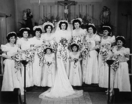 Wedding at St. Edward's (stone) Church Socorro Aguirre (DeVillar). Second from right: Hortenzia Martinez, Fourth from left: Frances Martinez.