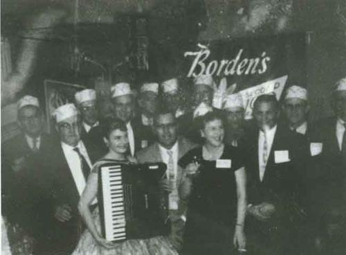 Party at Borden's Dairy Farm- Dutch and Edna Velthoen in front (?).