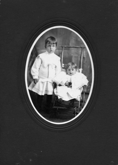 The photo is of Nathaniel Delos Hudson (on left) and Elladora Hudson. These two are children of Nathaniel Joy Hudson and Nellie Ethelyn Barber Hudson. The photo is from Bernice Jameson Todd collection. Years later, Elladora married ----Furbush