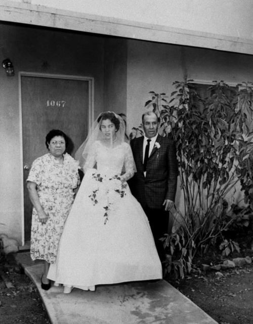 Varela Wedding. Victoria and Guadalupe Juarez with bride standing in front of 1067 Quarry Street.