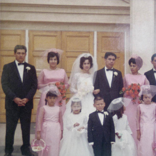 June 20, 1964.  The wedding of Rachel Salgado and Richard Hernandez.  Photo includes the wedding couple and several members of the wedding.