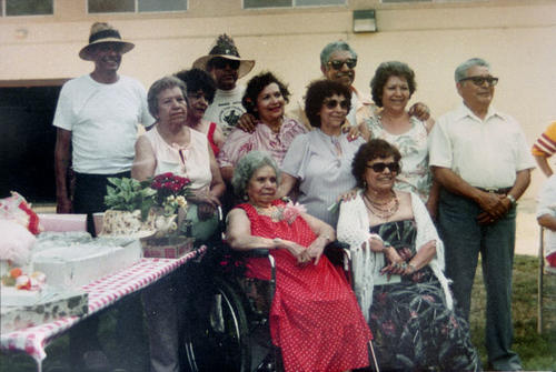sitting right to left: Elizabeth Villa, Maria Macial. Standing Left to Right: Peter Macial, Vicentia Macial Varela, Carmen Macial Mendoza, Johny Macial, Bandelina Maciel Rico, Christina Maciel Rivera, Paul Maciel, Hope Maciel Lomeli, Amado Maciel.