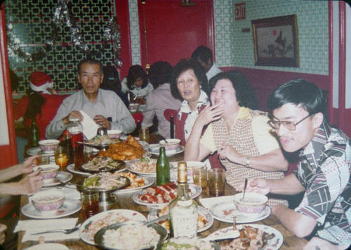 Thanksgiving party of Woo family.  From left to right: Fran Woo, Mrs. Fran Woo, Sou Chin, and Tony Woo.