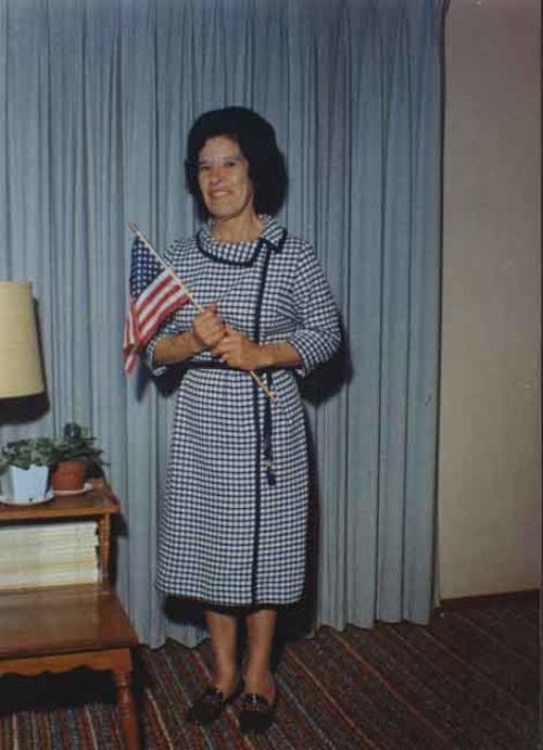 Mrs. Torres, Paul J. Ganahl's housekeeper with an American flag.  Mrs. Torres had just received her citizenship.  She cleaned houses for many Corona families.