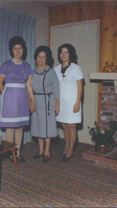 Mrs. Torres, Paul J. Ganahl's housekeeper with her two daughters.  Mrs. Torres had just received her citizenship.  Mrs. Torres cleaned houses for many Corona families.