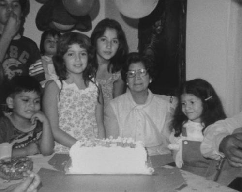 Party held at Beatrice Ramirez's home.  Charlotte Balderas Enrique and grandchildren.  Left to right: Joe Ramirez, Robert Martinez, LIsa Ramirez, Julie Salas, Charlotte, Jenniger Enriquez.