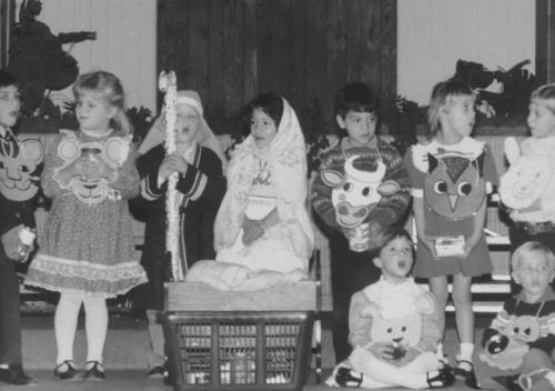 Christmas pageant for Crossroads Christian Preschool in December, 1985. Pictured: Adeel Husain (far left wearing cat), Timothy MacConnell (boy holding staff), Ross Pender (boy standing far right), and Paul O'Leary (boy seated far right).