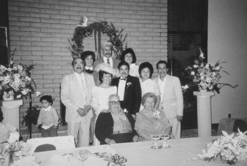 Gloria and Manuel Herrera's 25th wedding anniversary. Front: Joseph and Vicenta Varela (parents), brother Albert Varela, sister Gloria Varela Herrera, husband Manuel Herrera. Seated L-R: Lupe Varela, and husband Joe Varela. Rear: Josie Varela, Paul Varela, and Esther Munoz.
