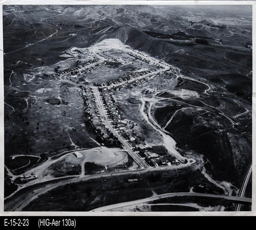 "This is a BW aerial view of the Cresta Verde Development, looking north.  In the photograph the following can be seen:  I-91 Freeway (lower area of the photograph), golf course, and the development.   This photograph is from the files of Milton Deacon. - MEASUREMENTS:  11"" x 14"" - CONDITION:  This photo is in good condition.  This photograph is kept in a Mylar sleeve. - COPIES:  1."