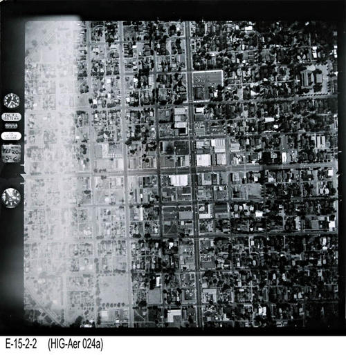 "This is an aerial view of Corona showing Main St., intersection 6th and Main St. at intersection center. - MEASUREMENTS:  10 1/4"" x 10 1/4"" - CONDITION:  This photo is in good condition. This photograph is in a protective sleeve. - COPIES:  1. - NEGATIVE INFORMATION:  # ON016"