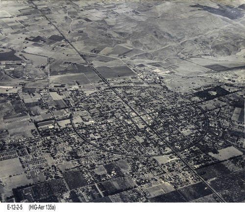 "This BW photo is an aerial view of Corona.  The full Grand Blvd. circle is visible.  - MEASUREMENTS:  19 13/16"" x 23 14/16 - CONDITION:  This photo is in good condition. - COPIES:  1"