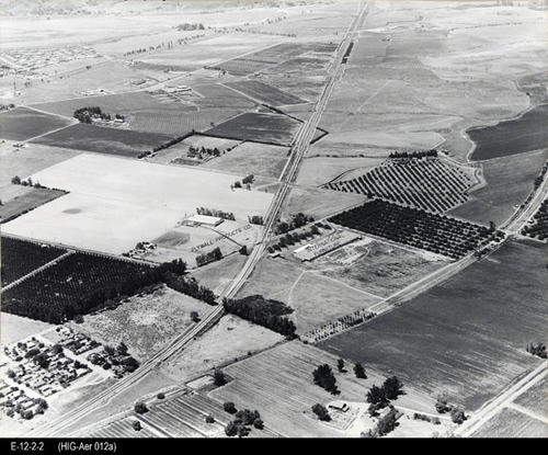 "This is BW aerial photos shows NW Corona.  The view location is Railroad Street. Identified structures in the picture are:  Plywall Products Co. and International Furniture. - MEASUREMENTS:  15 1/2"" x 19 1/4"" - CONDITION:  This photo is in good condition. - COPIES:  1"