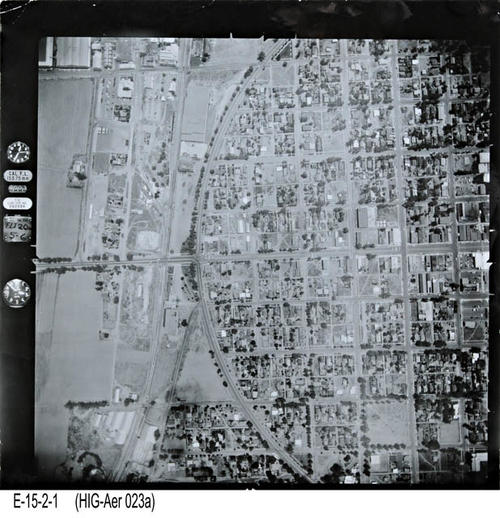 "This is an aerial view of Corona showing Main St. between 5th and No. Grand. - MEASUREMENTS:  10 1/4"" x 10 1/4"" - CONDITION:  This photo is in good condition. This photograph is in a protective sleeve. - COPIES:  1. - NEGATIVE INFORMATION:  # ON015"