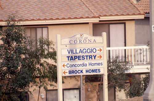 This slide is of a City of Corona direction sign for:  Villaggio, Tapestry, Brock and Concordia Homes