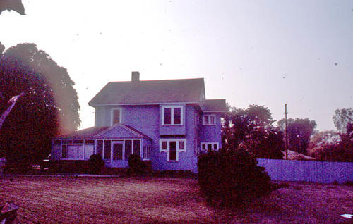This color slide is of the Corona residence located at 916 E. Grand Boulevard.  It was taken during April 1985.  - SLIDE CONDITION:  This slide is very dark and has been digitally enhanced to bring out color and detail.